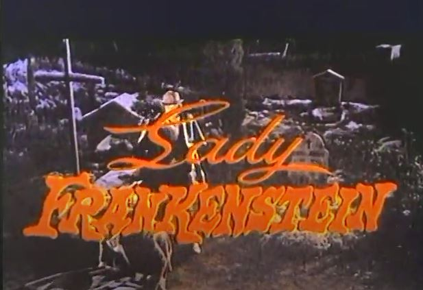 Lady Frankenstein is written in orange over a black and white movie image of a cemetery.