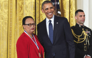 Shirley Ann Jackson standing beside President Barack Obama. She is wearing the National Medal of Science around her neck.