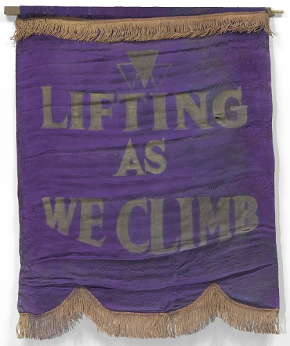Purple flag that says Lifting as we climb.