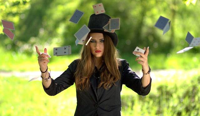 A magician surrounded by floating playing cards.