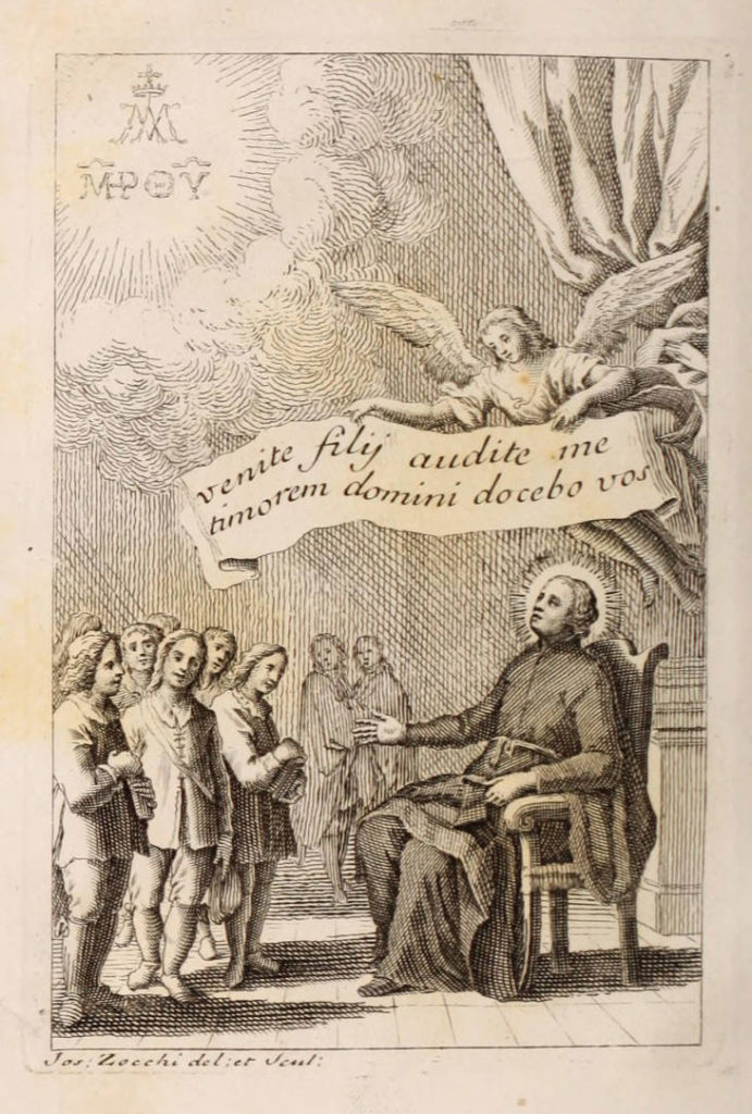"Black and white illustration of a man sitting in a chair, looking upward at an angel who is hovering above him. The angel holds a banner which reads, ""Venity fily audite me timorem domini docebo vos."" A group of men are standing around the man in the chair, looking towards him."