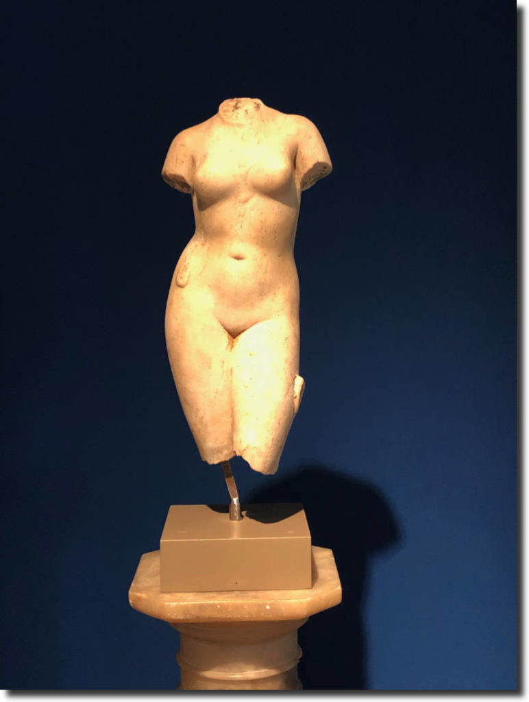Marble statue of the torso of Aphrodite.